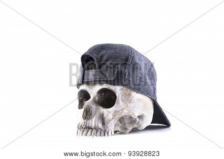 isolated human skull and cloth-cap