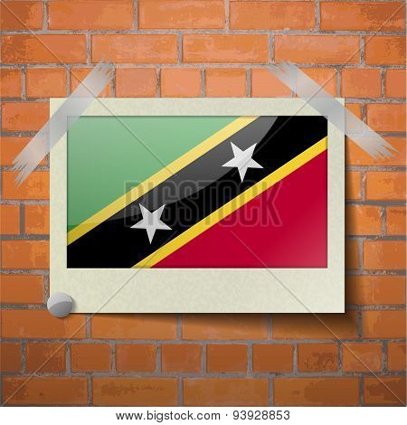 Flags Saint Kitts Nevis Scotch Taped To A Red Brick Wall