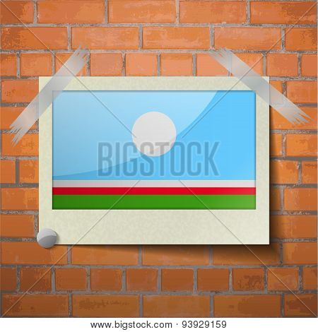 Flags Sakha Republic Scotch Taped To A Red Brick Wall