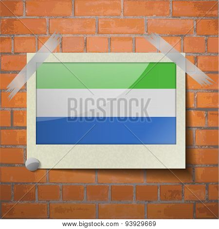 Flags Sierra Leone Scotch Taped To A Red Brick Wall