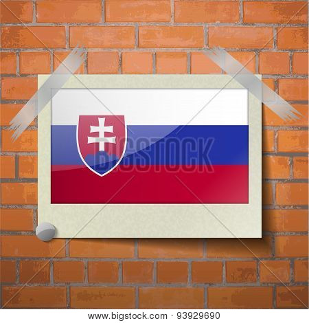 Flags Slovakia Scotch Taped To A Red Brick Wall