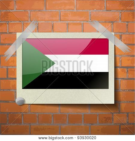 Flags Sudan Scotch Taped To A Red Brick Wall