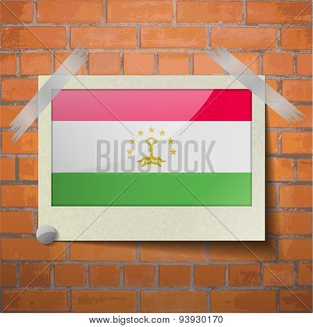 Flags Tajikistan Scotch Taped To A Red Brick Wall