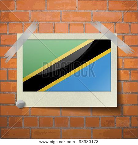 Flags Tanzania Scotch Taped To A Red Brick Wall