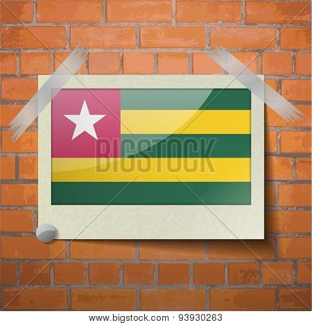 Flags Togo Scotch Taped To A Red Brick Wall