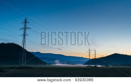 Fog On The Lake Near The Electric Poles .