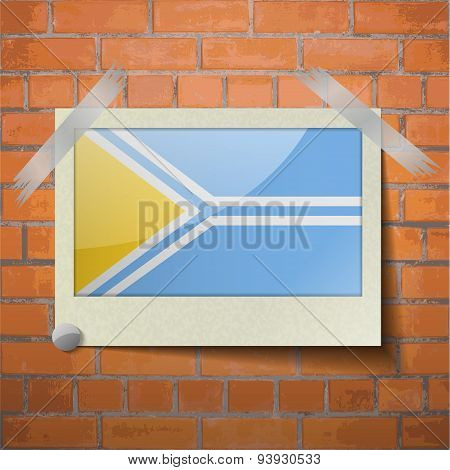 Flags Tuva Scotch Taped To A Red Brick Wall