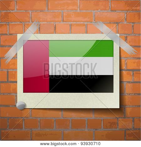 Flags United Arab Emirates Scotch Taped To A Red Brick Wall