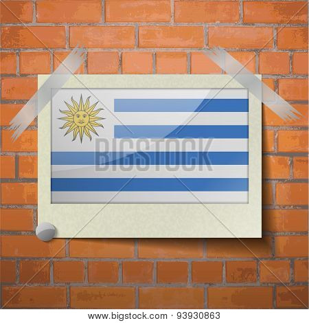 Flags Uruguay Scotch Taped To A Red Brick Wall