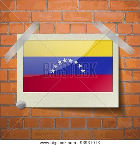 Flags Venezuela Scotch Taped To A Red Brick Wall
