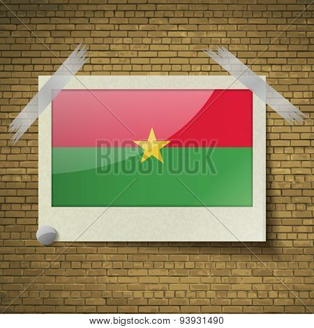 Flags Burkia Faso At Frame On A Brick Background. Vector