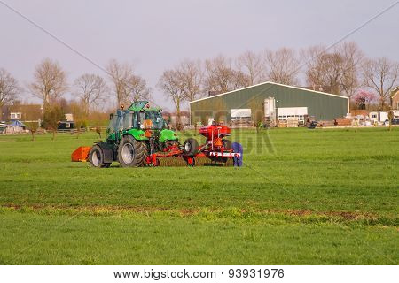 Tractor Operator On The Tractor Carries Out Field Work