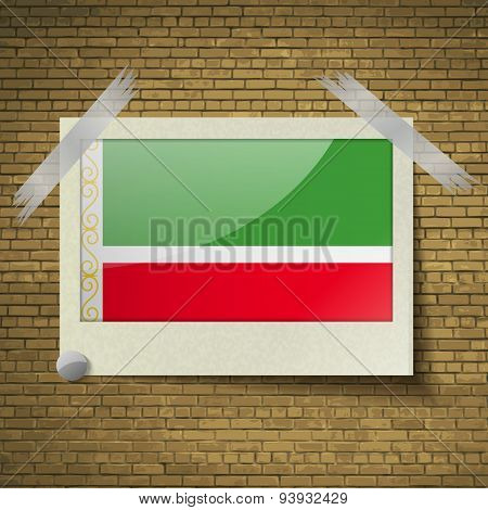 Flags Chechen Republic At Frame On A Brick Background. Vector