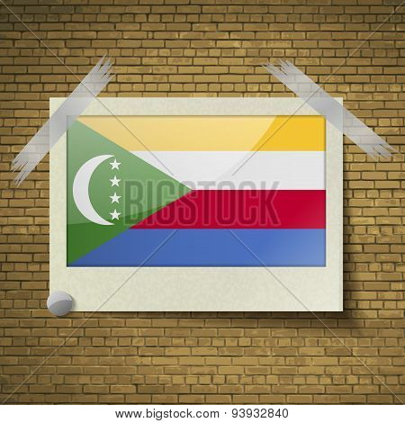 Flags Comoros At Frame On A Brick Background. Vector
