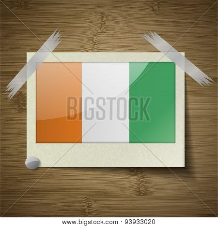 Flags Cote Dlvoire At Frame On Wooden Texture. Vector
