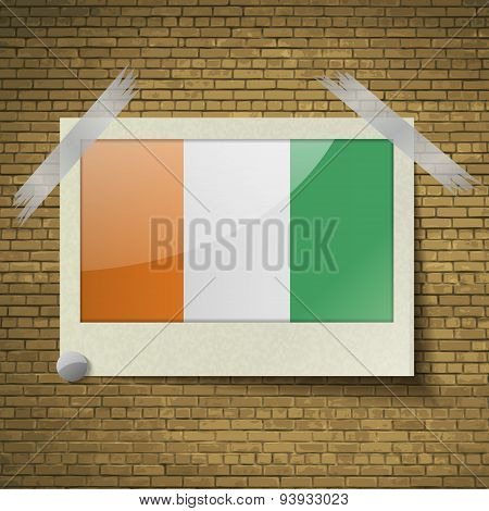 Flags Cote Dlvoire At Frame On A Brick Background. Vector