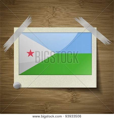 Flags Djibouti At Frame On Wooden Texture. Vector