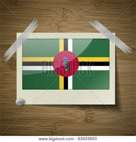 Flags Dominica At Frame On Wooden Texture. Vector