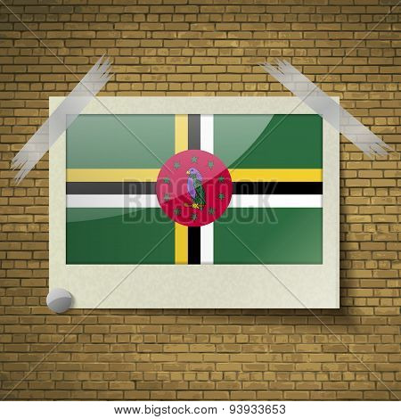 Flags Dominica At Frame On A Brick Background. Vector