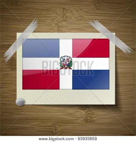 Flags Dominican Republic At Frame On Wooden Texture. Vector