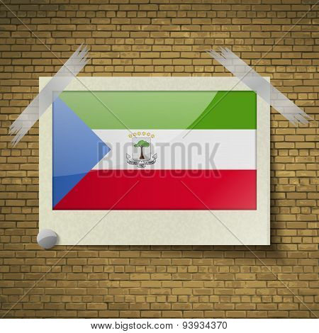 Flags Equatorial Guinea At Frame On A Brick Background. Vector