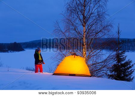 Woman in winter camping