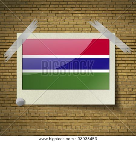 Flags Gambia At Frame On A Brick Background. Vector