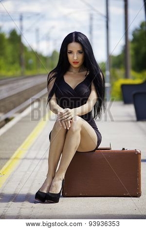 Young Woman Is Waiting For A Train On The Train Station