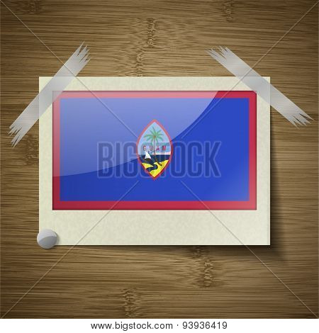 Flags Guam At Frame On Wooden Texture. Vector