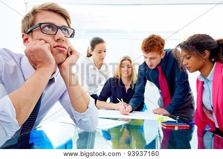 Bored young executive gesture in multi ethnic teamwork meeting at office