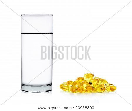 Water Of Glass With Fish Oil Capsules Isolated On The White Background
