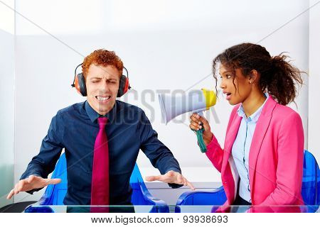 business woman talking in megaphone african ethnicity to young executive