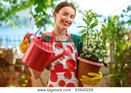 Young woman working in the garden