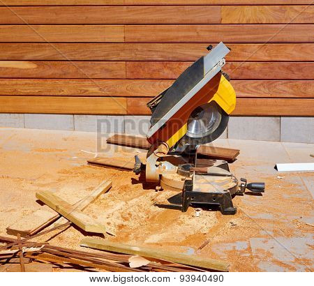 Ipe wood fence installation with carpenter table circular saw and sawdust