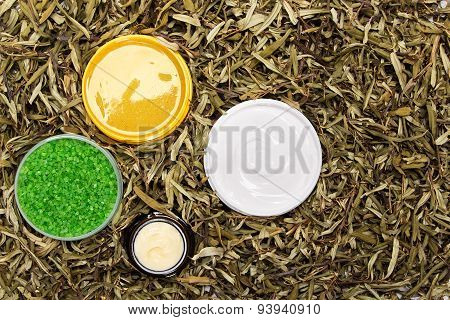 Cosmetic Body Care Products In Dry Leaves