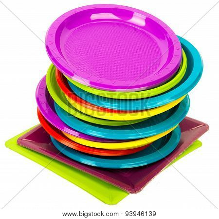Bright colorful plates stacked on white background