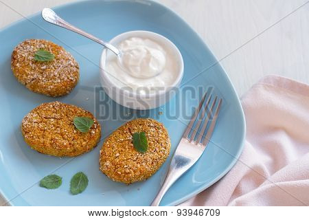 Healthy vegetable cutlets with carrot, breaded in oat bran
