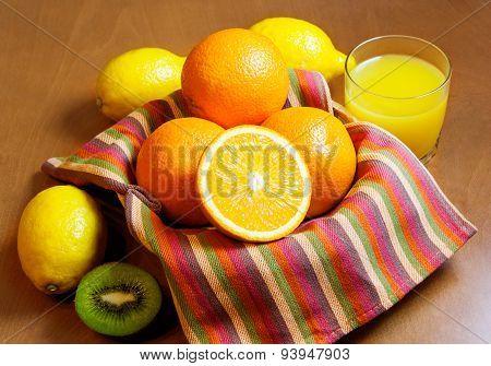 Oranges, Lemons, Kiwi  And Glass Of Orange Juice