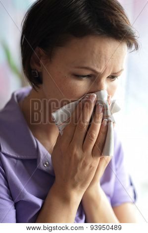 Young woman feels sickness