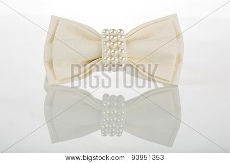 white bow tie with pearls