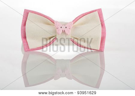 white bow tie with pink accents and a butterfly