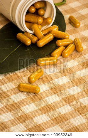 Medicine Bottles, Plastic Capsule Placed On Cotton.