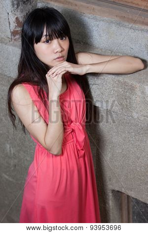 Asian Woman By Wall