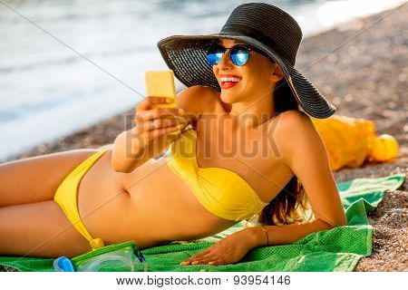 Woman making selfie on the beach