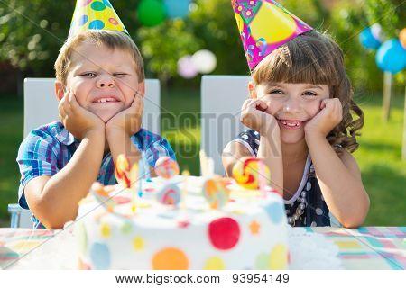 Happy Children Having Fun At Birthday Party