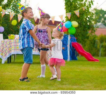Three Little Kids Dancing Roundelay