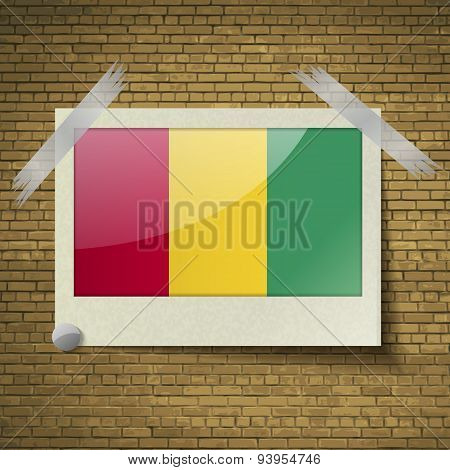 Flags Guinea At Frame On A Brick Background. Vector
