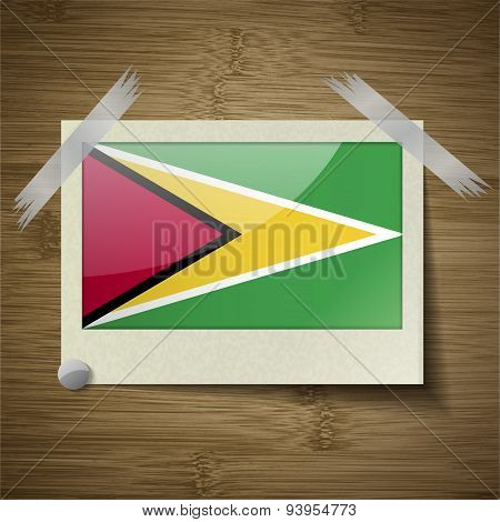 Flags Guyana At Frame On Wooden Texture. Vector