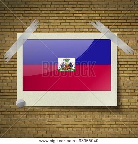 Flags Haiti At Frame On A Brick Background. Vector