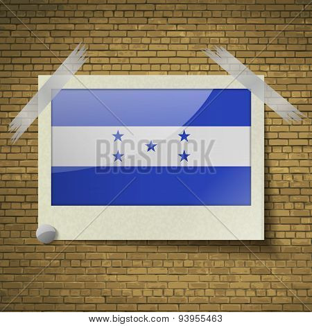 Flags Honduras At Frame On A Brick Background. Vector